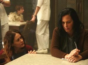Lana (Sarah Paulson) talks to Anne Frank (Franka Potente) in FX's American Horror Story Asylum