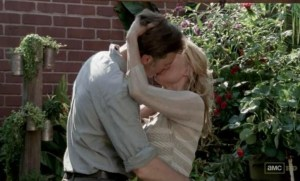 The Governor (David Morrissey) kisses Andrea (Laurie Holden) in AMC's The Walking Dead