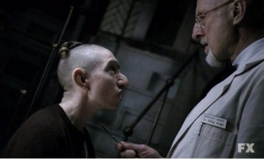 Pepper (Naomi Grossman) and Dr. Arden (James Cromwell) chat in American Horror Story: Asylum Episode 10