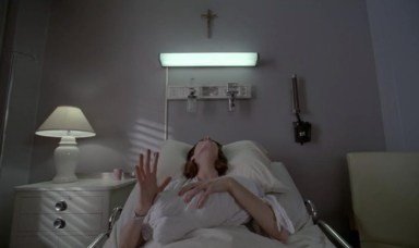 Lana (Sarah Paulson) has flashbacks in episode 11 of American Horror Story: Asylum
