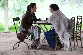 Lana Winters (Sarah Paulson) talks to Kit (Evan Peters) in Episode 13 of FX's American Horror Story: Asylum