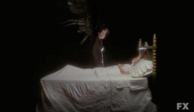 The Angel of Death (Frances Conroy) and Sister Jude (Jessica Lange)  in episode 13 of FX's American Horror Story: Asylum