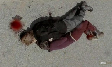 Carol (Melissa McBride) uses Axle's body as a Shield in Episode 10 of AMC's The Walking Dead