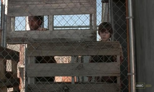 Rick (Andrew Lincoln) and his son, Carl (Chandler Riggs) in episode 11 of AMC's The Walking Dead