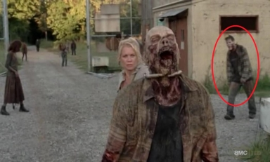 Reccurring zombie man sneaks up on Andrea (Laurie Holden) in episode 11 of AMC's The Walking Dead