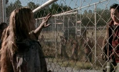 Glenn (Steven Yeun) 'finds' an engagement ring for Maggie (Lauren Cohan) in Episode 15 of AMC's The Walking Dead