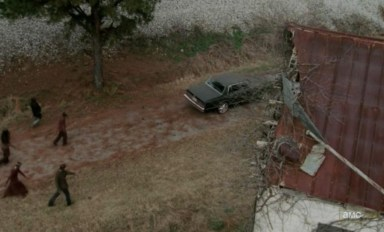 Merle (Michael Rooker) leads the zombies to Woodbury in Episode 15 of AMC's The Walking Dead