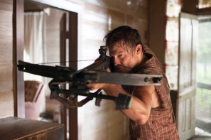 Is it a squirrel or a zombie? Daryl Dixon (Norman Reedus) takes aim in AMC's The Walking Dead