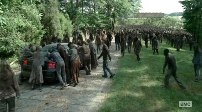 Daryl's (Norman Reedus) car gets mobbed in AMC's The Walking Dead, Season 4, Episode 3, entitled 'Isolated'.