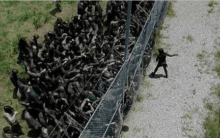 Maggie (Lauren Cohan) singlehandedly takes on the walkers in AMC's The Walking Dead, Season 4, Episode 5, entitled 'Internment'