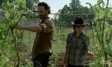 Rick (Andrew Lincoln) picks peas with Carl (Chandler Riggs) rather than tell Daryl (Norman Reedus) about Carol (Melissa McBride) in AMC's The Walking dead, Season 4, Episode 5, entitled 'Internment'