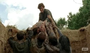 The Governor (David Morrissey) pays back Martinez (Jose Pablo Cantillo) for rescuing him by feeding him to the zombies in AMC's The Walking dead Season 4, Episode 7, entitled 'Dead Weight'