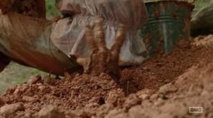 Meagan (Meyrick Murphy) gets bitten in AMC's THe Walking Dead Season 4, Episode 8, entitled 'Too Far Gone'