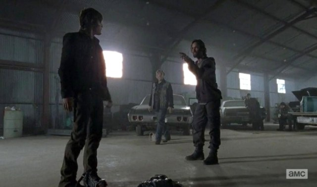 Daryl Dixon (Norman Reedus) fights over a bunny in Season 4, Episode 15 of AMC's The Walking Dead