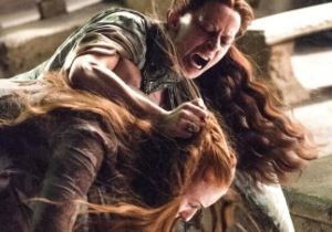 Lysa (Kate Dickie) and Sansa (Sophie Turner) have a scrag fight in Season 4, Episode 7 (Mockingbird) of HBO's Game of Thrones