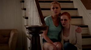 Sookie Stackhouse (Anna Paquin) and Jessica Hamby (Deborah Ann Woll) cry over Bill Compton's (Stephen Moyer) Hep-V status in HBO's True Blood Season 7 Episode 6 (entitled 'Karma')